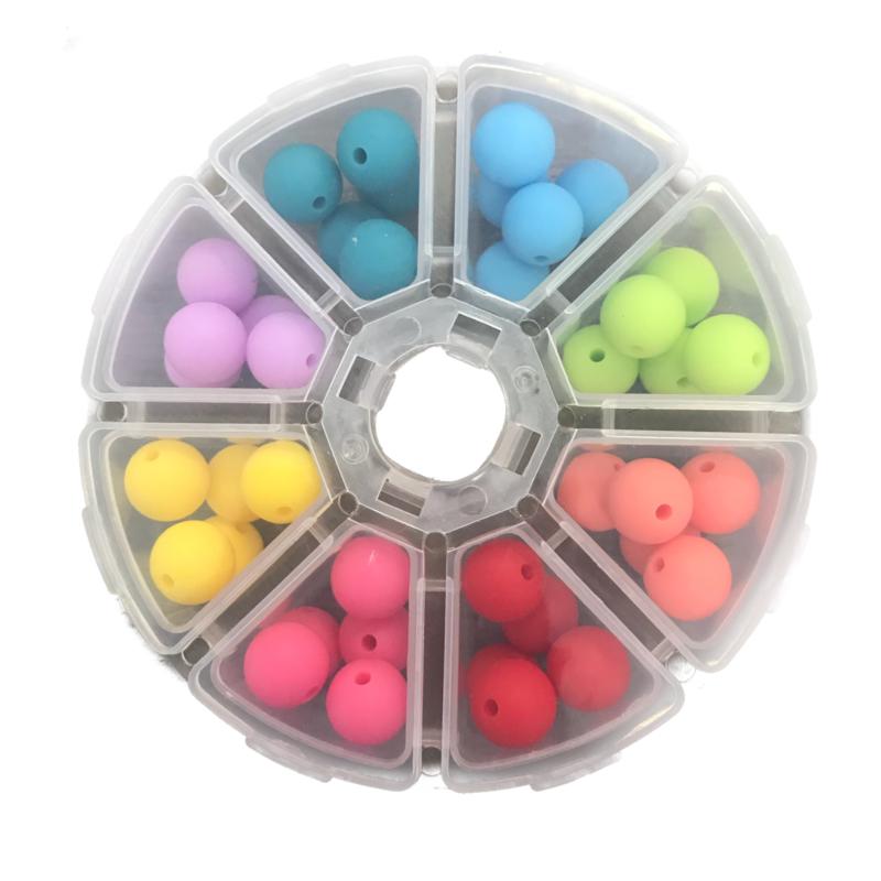 Doosje met 40 siliconen kralen van 12 mm Heldere kleurtjes