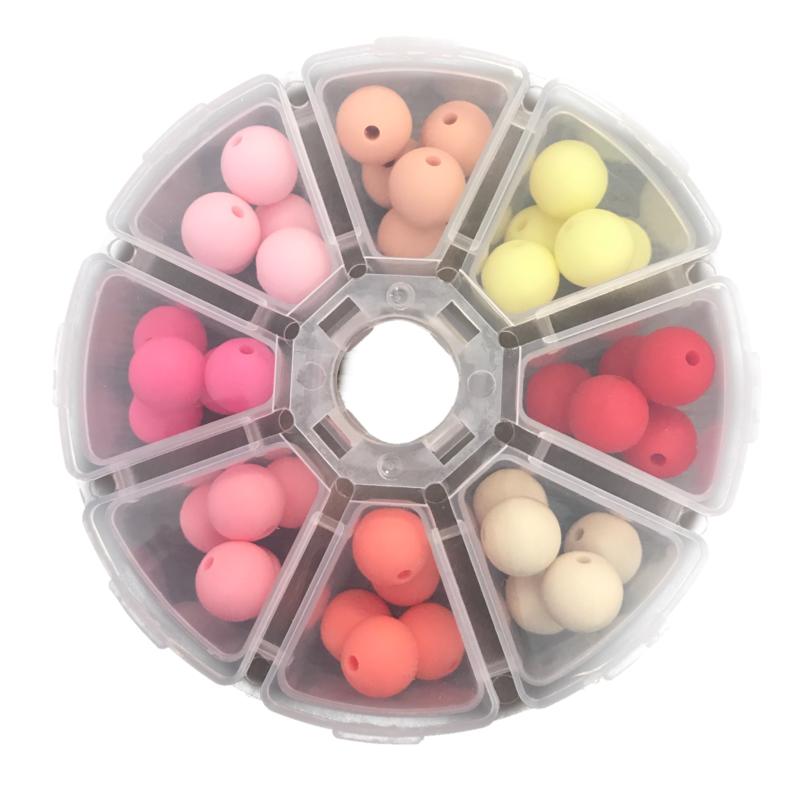 Doosje met 40 siliconen kralen van 12 mm Roze tinten