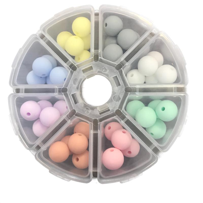 Doosje met 40 siliconen kralen van 12 mm Pastel kleurtjes