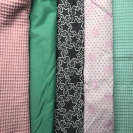 boxkleed en boxzak mintgroen, zacht roze en grijs.