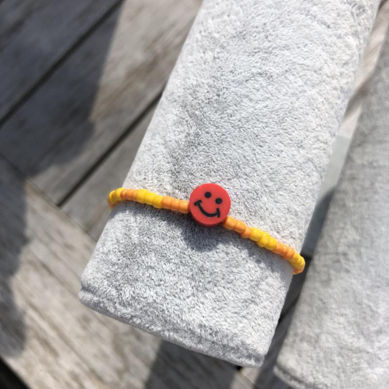 Armbandje oranje-geel smiley