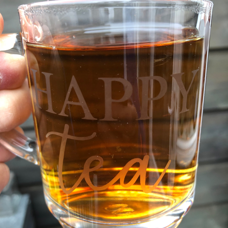 Happy tea theeglas