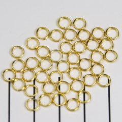 5mm Dubbel ringetjes, 0,7mm Goudkleur / KD909