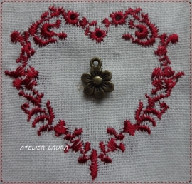 Bedel bronskleurig bloemetje