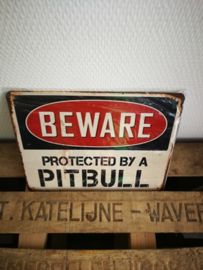 Beware protected by a pitbull