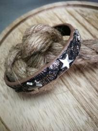 Zilverkleurige ster op zwart armband