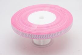 10.05 Roze lint met wit gekartelde opdruk