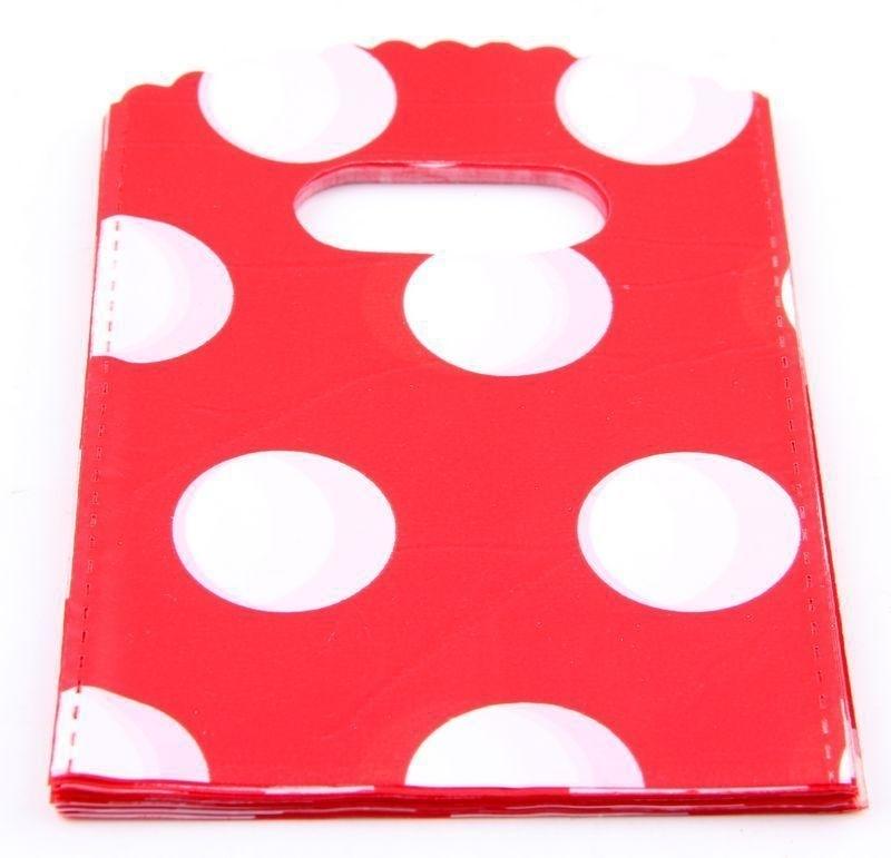 Rode tasjes met witte stippen