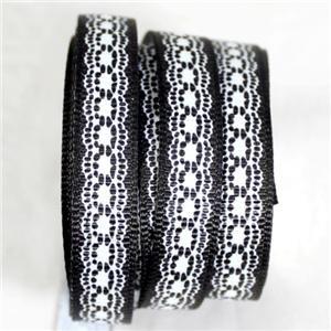 10.04 Zwart lint met wit kanten opdruk