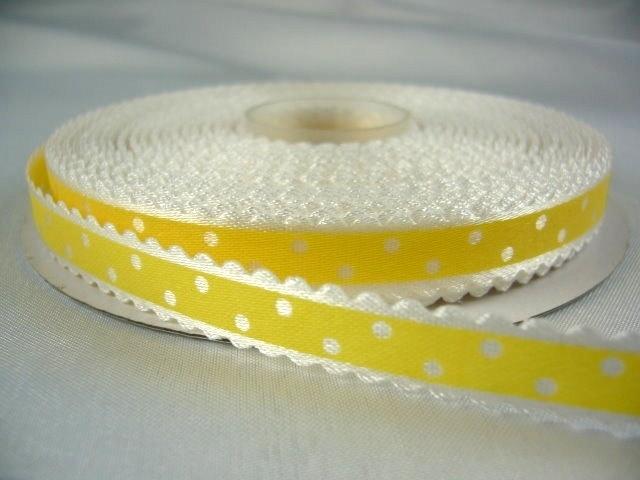 10.03 Wit lint met kartel randje en gele opdruk