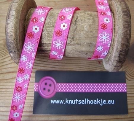 10.06 Roze lint met witte en rode bloemen