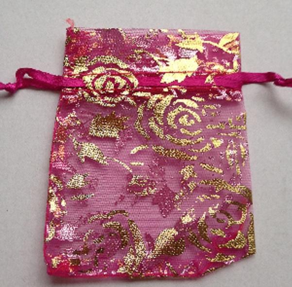 18.03 9x7 donker roze organza zakjes met rozen