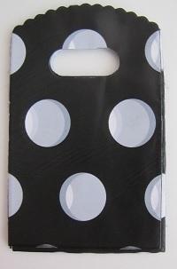 Zwarte tasje met witte stippen