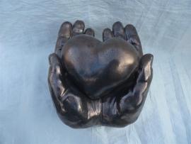 Hart in handen middel