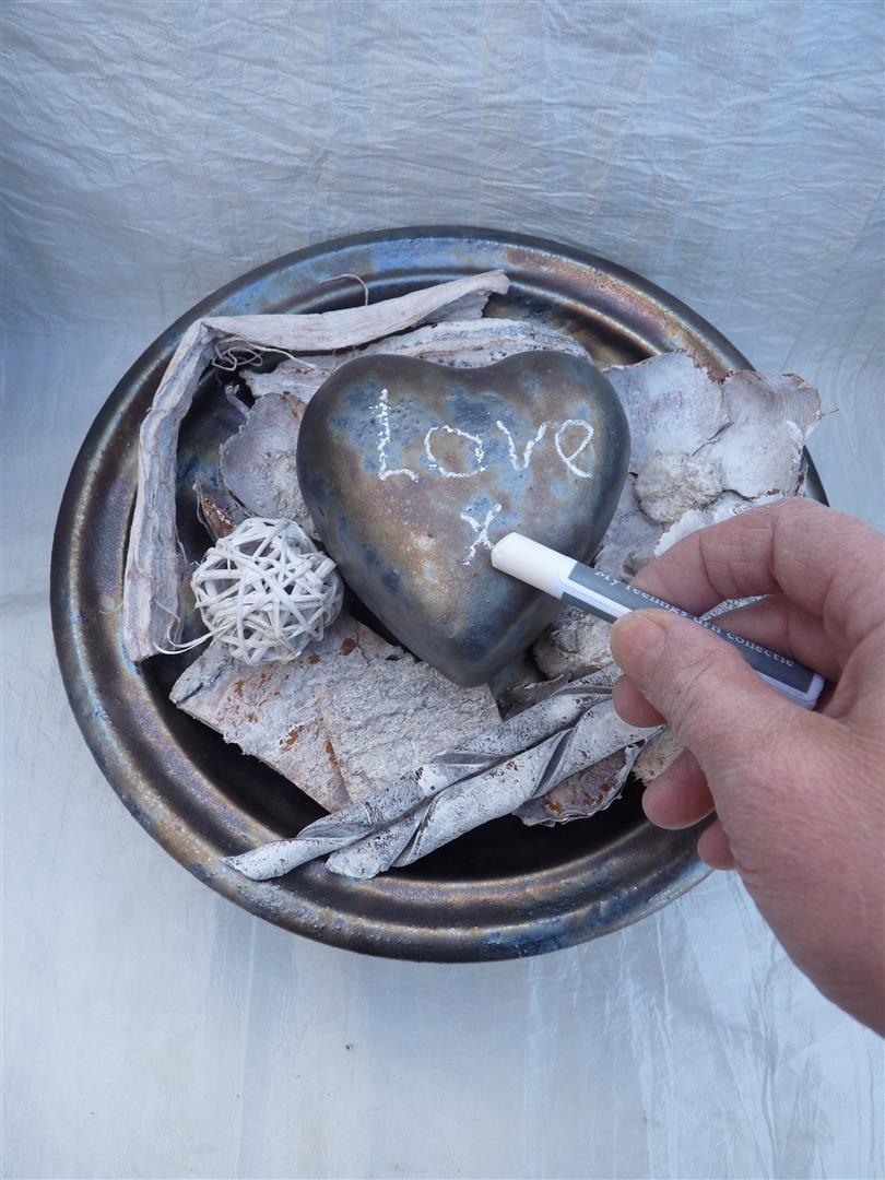 hart met schaal urn