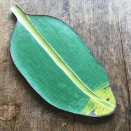 Houten bord bananenblad