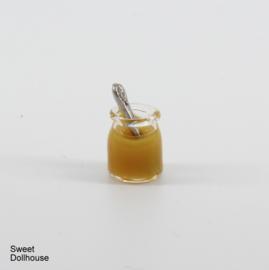 Glazen potje met honing