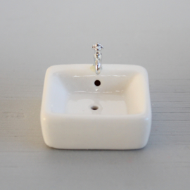 Square sink with tap