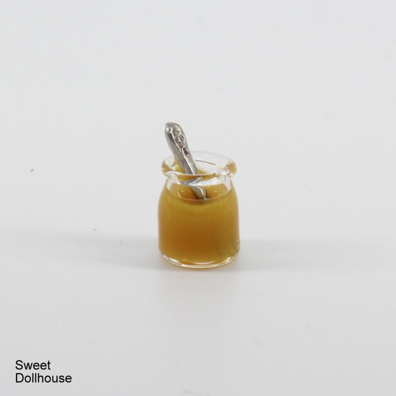Glass jar with honey