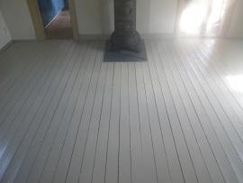 Houten vloer met lijnolieverf