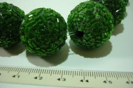 +[ 7081 ] Keramiek kraal 24 mm. Groen, per streng á 7 stuks