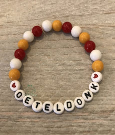 Armbandje met Oeteldonk letters wit en hartjes