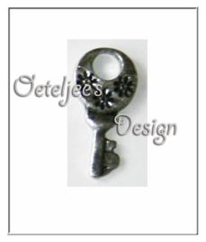 Bedel - Metaal sleutel met bloem motief