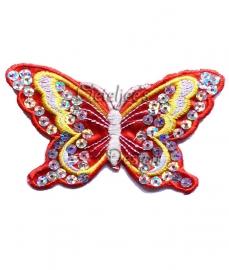 Vlinder met pailletten rood, wit geel