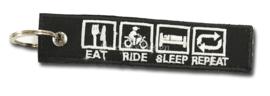 "Sleutelhanger ""Eat Ride Sleep Repeat"""