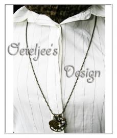 Halsketting - Brons met bedels en glaskralen