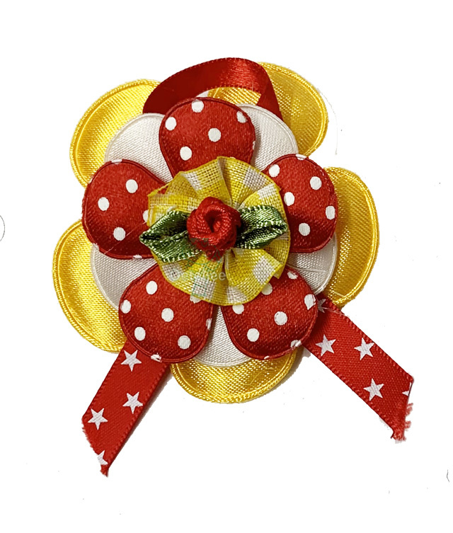 Corsage bloem Oeteldonkse kleuren rood wit geel sterretjes lint