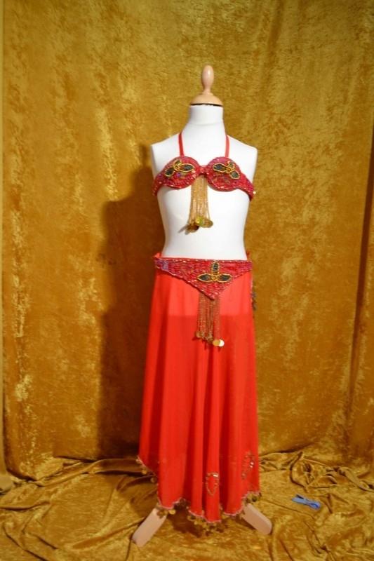 Kostuum fuchsia-rood/goud