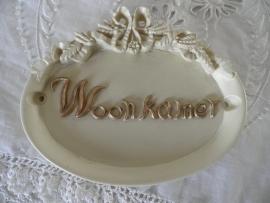 Beige deurbordje met `Woonkamer`