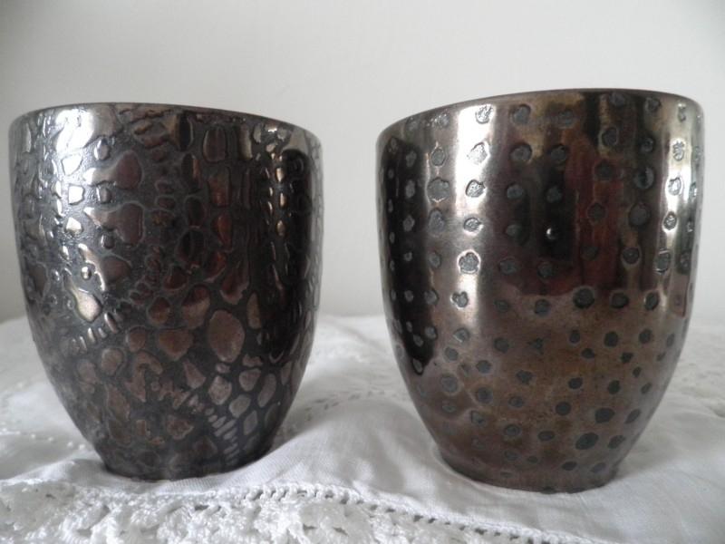 2 Bruine waxinehouders met motief VERKOCHT