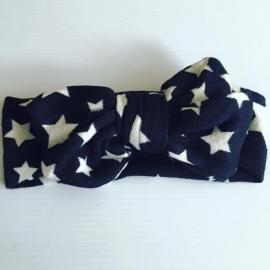 Haarband met strik(zwart met witte sterren..)
