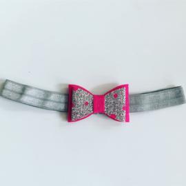 Haarbandje met strik fuchsia/zilver
