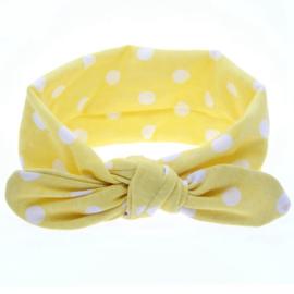 Zachte knoop haarbandje..Licht geel met witte stippen