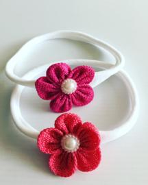 Nylon haarbandje met bloem koraal