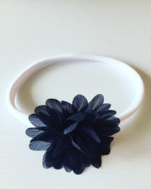 Nylon Haarbandje met glitter bloem.