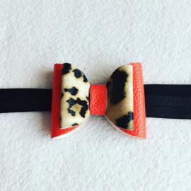 Zwart haarbandje  met strik  rood/panterprint