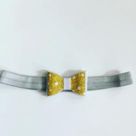 Haarbandje met strik zilver/goud
