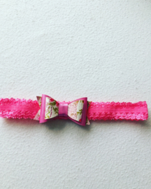 Haarbandje met strik rose/gebloemd