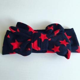Haarband met strik (zwart met rode sterren)