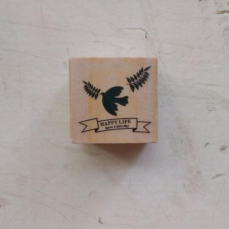 stempel - vogel met takje