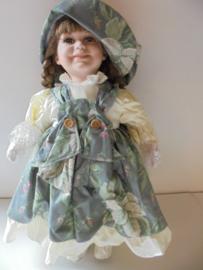 pop roos 45 cm met porselein hoofd &handen en voeten prijs per stuk