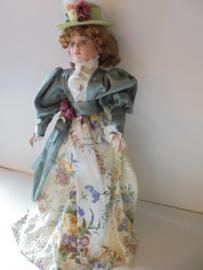 pop  tessa 44 cm met porselein hoofd &handen en voeten prijs per stuk