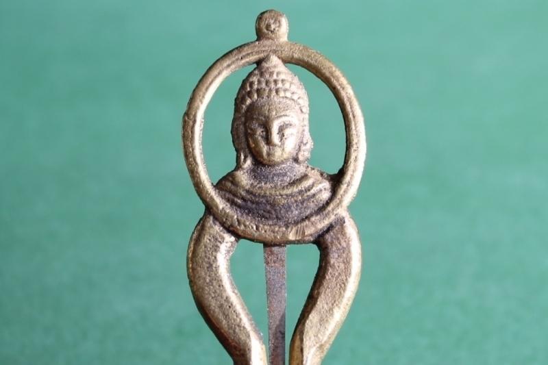 Buddharupa, mondharp met boeddha beeltenis