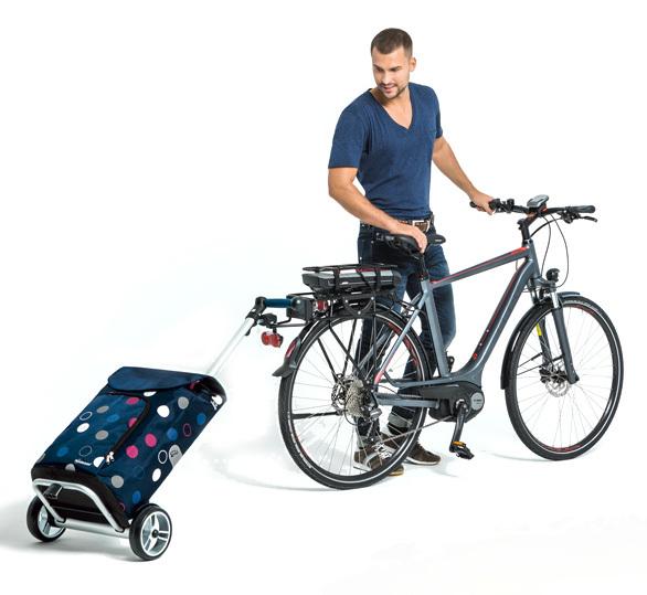 Unus boodschappenwagen achter de fiets bevestigd