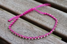 Armbandje blinkertjes roze