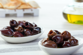 """Zwarte olijven """"Taggiasca"""" ontpit, in extra vergine olijfolie 175 g \ T.h.t. 30-06-2022"""